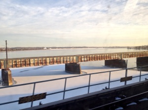 A frozen-ish Potomac River with snow on top.